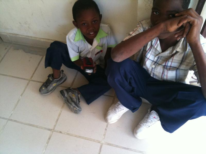 Boy in Haiti receiving Brookstone Radio/Flashlight